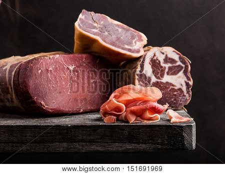 Italian prosciutto on rustic background
