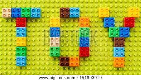 word of TOY shaped by toy bricks