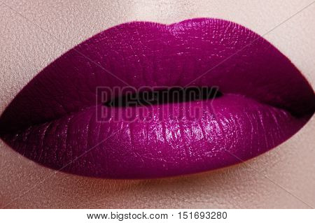 Close-up Shot Of Woman Lips With Glossy Fuchsia Lipstick. Perfec
