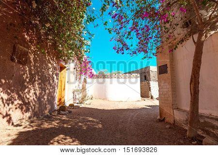 Narrow street in the town of Dahab, Egypt