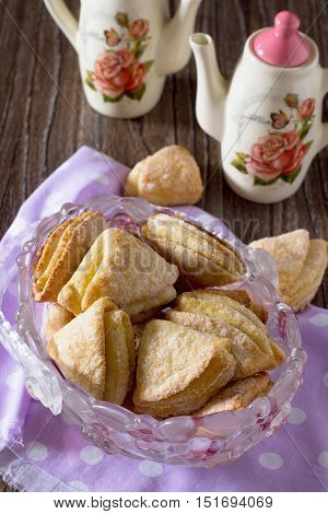 Cookies From Puff Pastry (shortcrust Pastry With Cheese) On A Wooden Table.