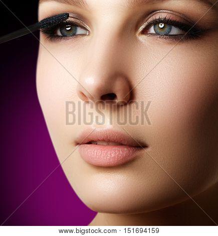 Mascara Applying Closeup, Long Lashes. Mascara Brush. Eyelashes