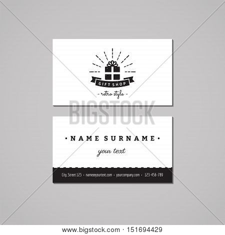 Gift shop and souvenirs business card design concept. Logo with gift box ribbon and rays. Vintage hipster and retro style. Black and white.