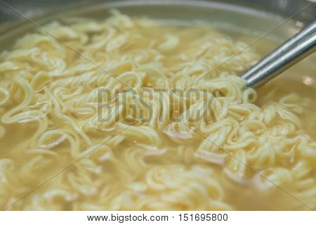 bowl of instant noodles with chopsticks close up