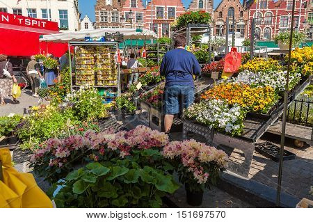Bruges, Belgium - April 6, 2008: Woman Selling Flowers On Markt Square