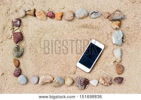 Stone Frame On Beach And Mobile