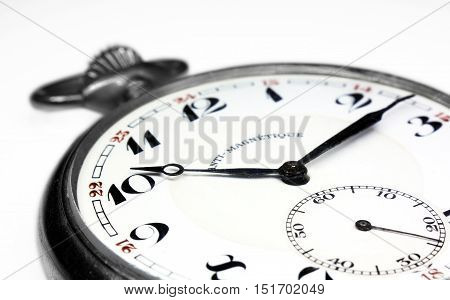 Old swiss pocket watch very close up perspective left isolated on white background