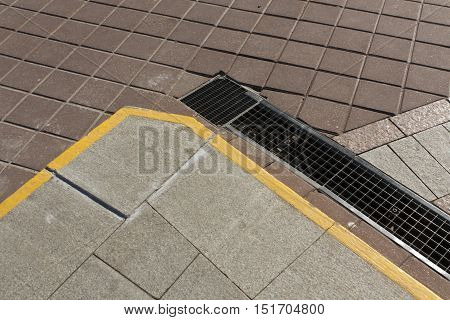 Stone Pavement With Metal Grid Drainage System.