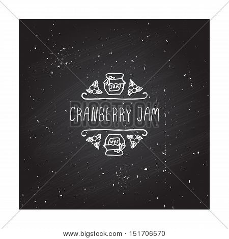 Hand-sketched typographic element with pumpkin, maple leaves and text on blackboard background. Cranberry jam