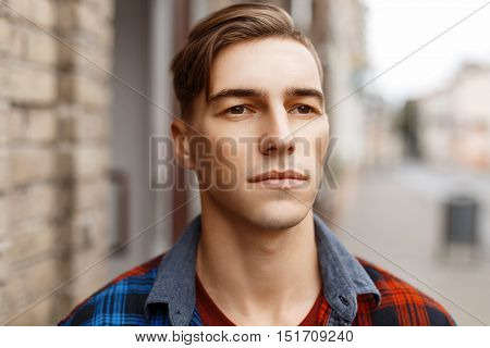 Male Face Outdoors. Portrait Of A Handsome Man With A Haircut