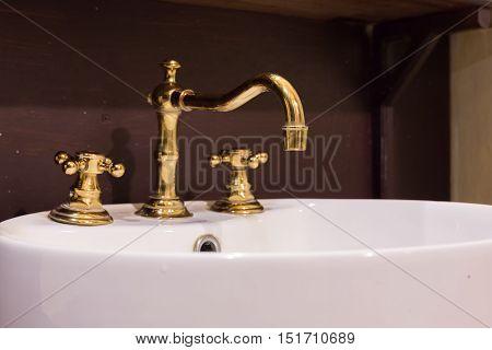 gold faucet and washbasin design retro vintage decorated luxury interior bathroom