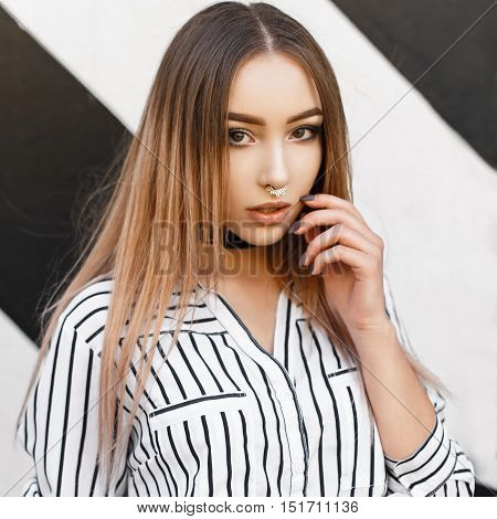 Young Pretty Woman In Stylish Clothes Near The Wall. Black And White Lines