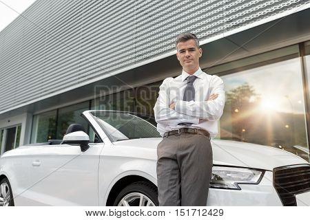 Car Salesman Posing At The Showroom