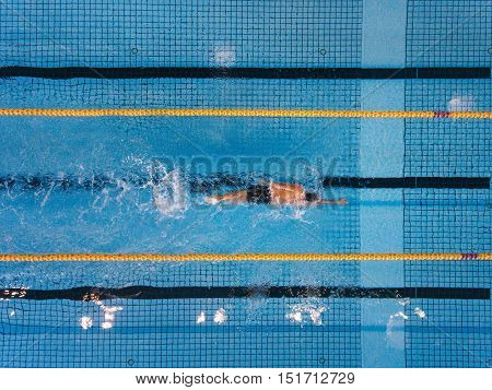 Young Man Swimming Laps In A Pool
