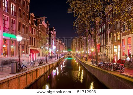 Red light district in Amsterdam Netherlands at night. Nightlife in in Amsterdam Netherlands