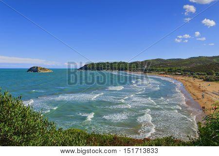 Summertime.Gargano coast: Portonuovo beach,Vieste-(Apulia) ITALY-In the background the Gattarella island.