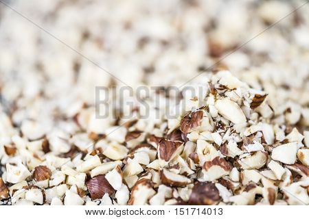 Minced Hazelnuts (selective focus; close-up shot) for use as background image or as texture