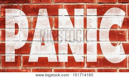 Panic Written On A Red Brick Wall