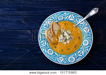 Creamy butternut squash soup with blue cheese and thyme top view horizontal for banner