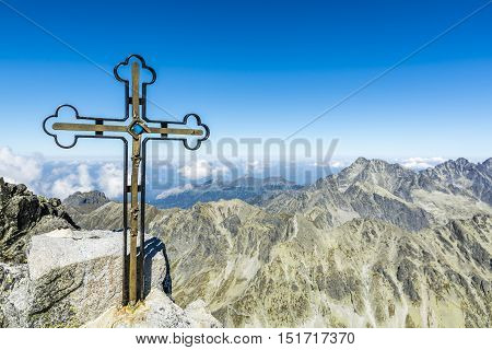 Cross on Gerlach Peak and the surrounding mountains autumn season.