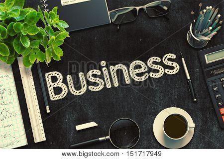 Business Concept on Black Chalkboard. 3d Rendering. Toned Image.
