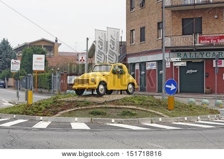 TURIN ITALY - OCTOBER 2: Model of Fiat Topolino 500 C oldtimer from 1936-57 is palced at one roundabout in Borgaro a suburb of Turin Italy on October 2 2106