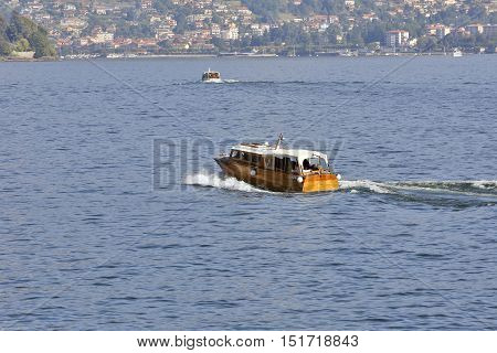 LAGO MAGGIORE, ITALY - SEPTEMBER 25: Connection with and between Borromees islands on the lake cater to these speedboats in Lago Maggiore Italy on September 25 2016