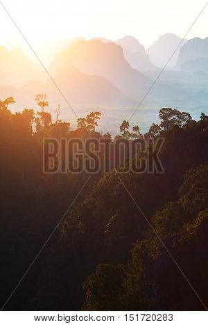 Mountain silhouettes at sunset in Thailand. asia sunset