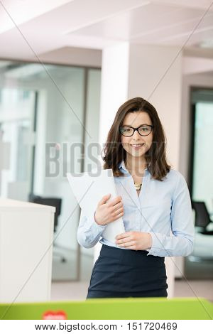 Portrait beautiful young businesswoman holding spiral book in office
