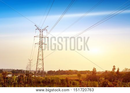 High-voltage transmission tower erected in the open field