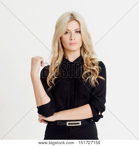 Happy and surprised young confident business lady, looking at the camera, white background.