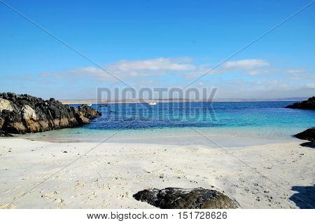 Panoramic view onto the ocean with a boat in the background at the beach in Bahia Inglesa in Chile, South America