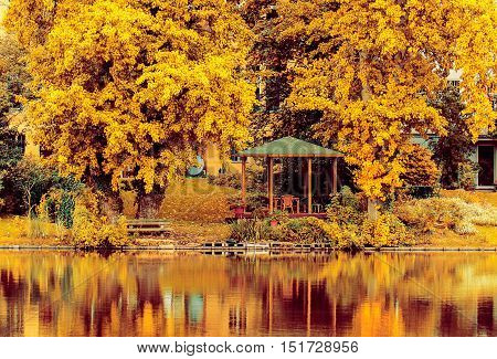 A view on an autumn park with lake and an arbor. Lietzensee Berlin Germany.
