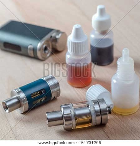 E-cigarettes with lots of different re-fill bottles close up