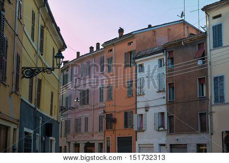Ancient Colorful Building Facade In Parma, Italy
