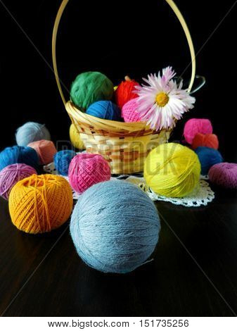 Set of multicoloured yarn for knitting on the wooden table