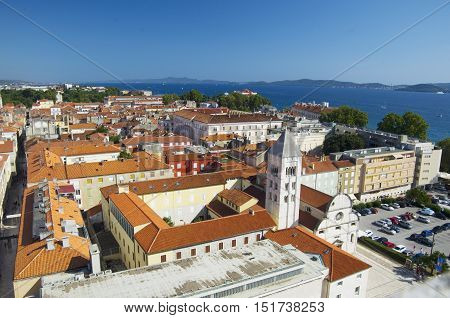 ZADAR CROATIA - JULY 12 2016: Zadar city from tower red roofs of old parts of town situated on the waterfront. Zadar is famous tourist spot at Adriatic sea coast in Dalmatia.