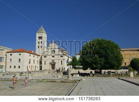 ZADAR CROATIA - JULY 12 2016: St. Donat church forum and Cathedral of St. Anastasia bell tower in Zadar Croatia. Zadar is famous tourist spot at Adriatic sea coast in Dalmatia.