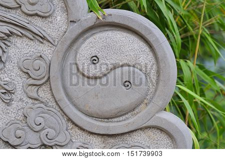 A yin and yang symbol on a stone wall at Hunyuan hall in the Taiping Palace scenic area in Qingdao China in shandong province.
