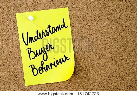 Understand Buyer Behaviour Text Written On Yellow Paper Note