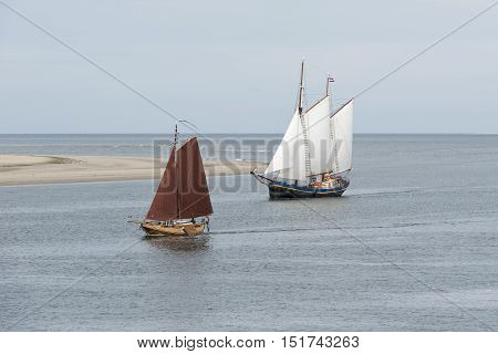 Old historic sailing boats on the edge of the North Sea and Wadden Sea near the wadden Island Vlieland
