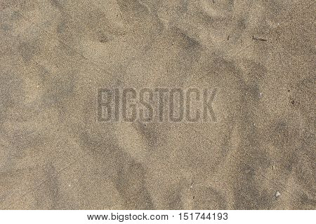 Beach sand closeup for background. Tropical beach macro photo. Exotic island sandy beach texture. Sand surface backdrop for vacation template holiday card or banner. Seaside sand surface picture