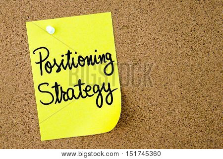 Positioning Strategy Text Written On Yellow Paper Note