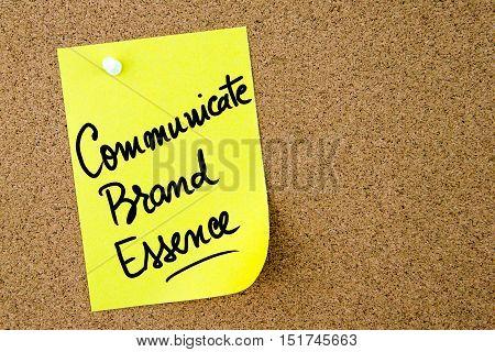 Communicate Brand Essence Text Written On Yellow Paper Note