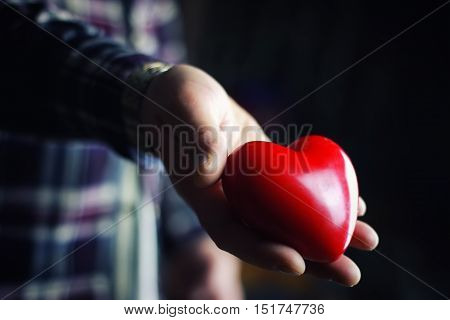 hand give on valentine red heart shape