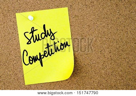 Study Competition Text Written On Yellow Paper Note