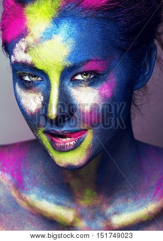 beauty woman with creative make up like Holy celebration in India close up