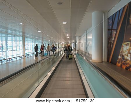 LONDON HEATHROW UK - CIRCA DECEMBER 2014: people on moving walkalator at the airport