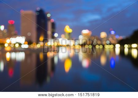 Reflection blurred light city office building with twilight sky background