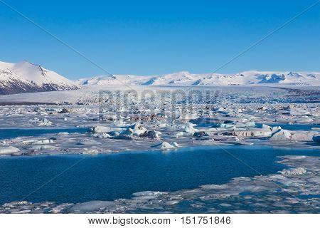 Icelandic Jokulsarlon lagoon in winter season natural landscape background
